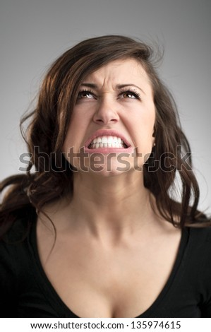 An angry young Caucasian woman portrait. - stock photo