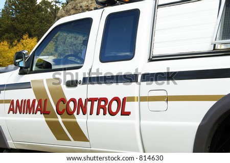 An animal control vehicle on duty in an urban setting.