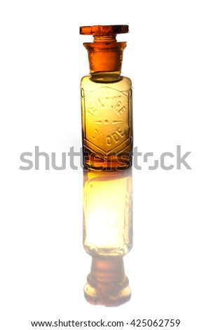 """An antique and vintage  glass bottle for pharmaceutical use of """"Teinture d'iode"""" (means Tincture of iodine), that is an antiseptic medicine, isolated on a white background. - stock photo"""