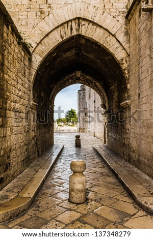 an antique archway in the old town of Barletta, Italy - stock photo