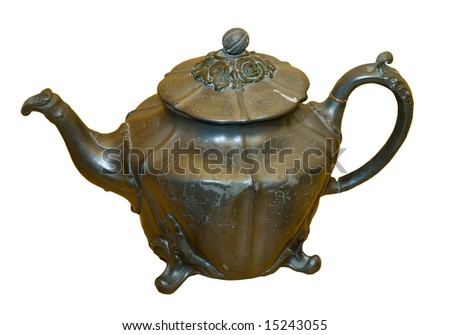 An antique brass teapot isolated on a white background