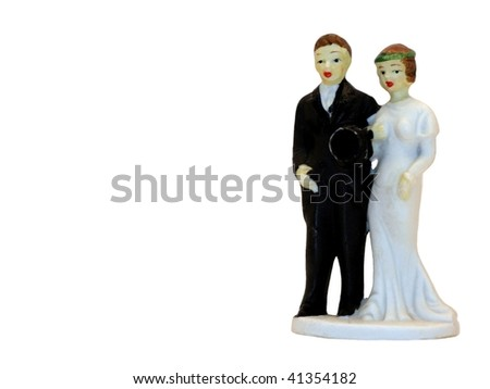 An antique ceramic wedding cake topper - stock photo