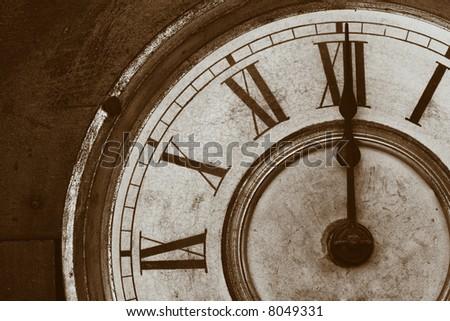 An Antique Clock Face in a brown sepia tone. - stock photo