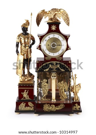 An antique clock ornate with golden figurines of Roman mythology.