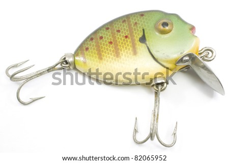 An antique fishing lure in the shape and color pattern of a pumkinseed. - stock photo