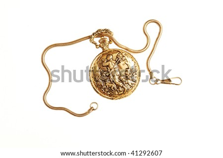 An antique gold pocket watch with chain and wonderful engraving on the lid. - stock photo