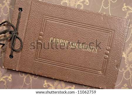 An antique photo albumn. - stock photo