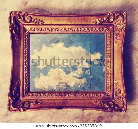 an antique photo frame with a cloud in it  toned with a retro vintage instagram filter effect  - stock photo
