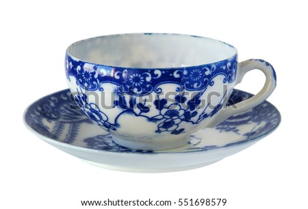 An antique porcelain cup and saucer isolated on white background