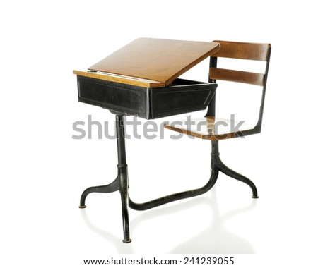 An antique school desk with an opened flip-top.  Isolated on white. - stock photo