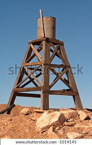 An antique water tower from the wild west. - stock photo