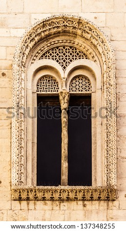an antique window with a lot of complex carvings and friezes - stock photo