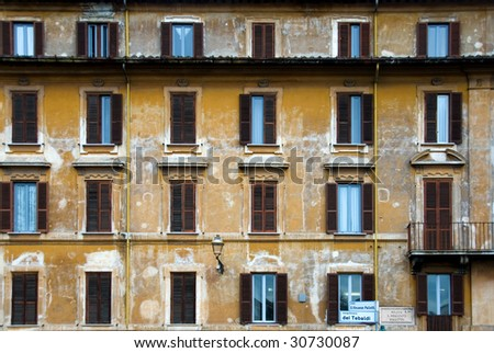 An apartment building, in Rome, Italy, which appears to be badly in need of some paint - stock photo