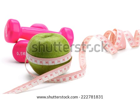 An apple, a measuring tape and dumbbell.