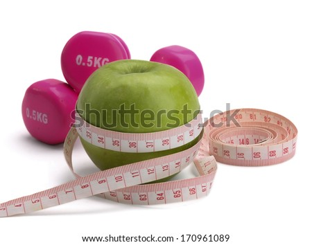 An apple, a measuring tape and dumbbell, isolated on white background