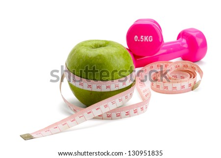 An apple, a measuring tape and dunbbell, isolated on white background - stock photo