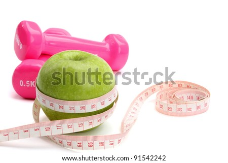 An apple, a measuring tape and dunbbell , isolated on white background - stock photo