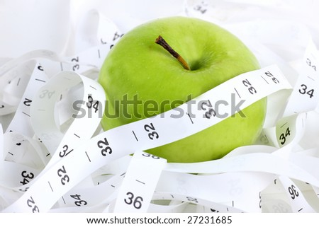 an apple and a measure tape; isolated on white - stock photo