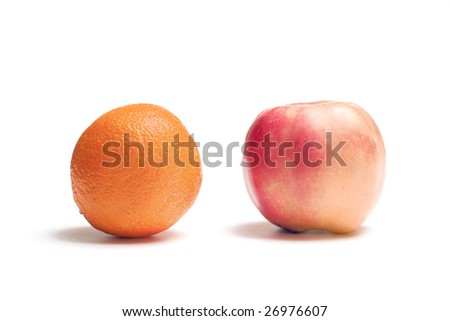 An apple and orange isolated on white.