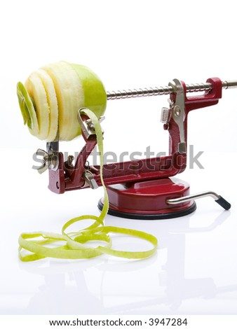 An Apple Corer And Slicer With An Apple - stock photo