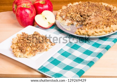 An apple crumb top pie with with apples - stock photo