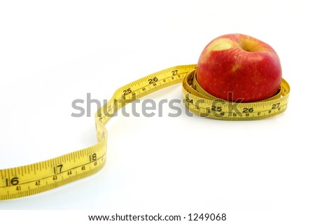 An Apple tighten with measure tape - stock photo