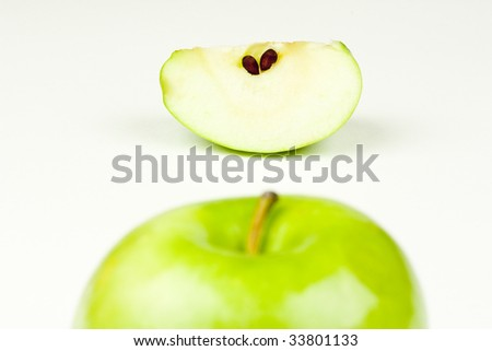 An apple top and apple slice - stock photo