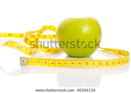 An apple with centimeter. Over white background. - stock photo