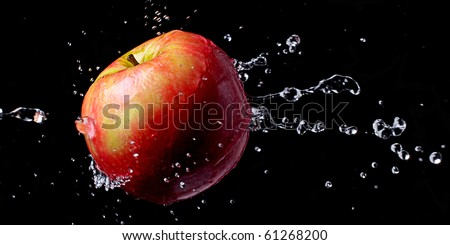 An apple with water drops/splash - stock photo
