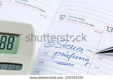 an appointment is entered in a calendar: tax audit - stock photo