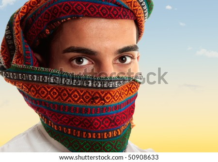 An arab middle eastern man wearing a coloured omani royal keffiyeh which can also be worn like a turban - stock photo