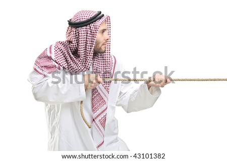 An Arab person pulling a rope isolated on white background - stock photo
