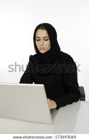 An Arab Student Working On Her Laptop - stock photo