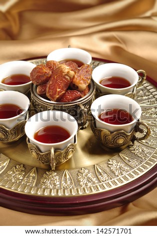 An arabic tea set with dates - stock photo
