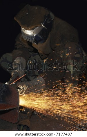 an arc welder spraying a lot of fire