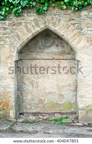 An arch niche in a stone wall