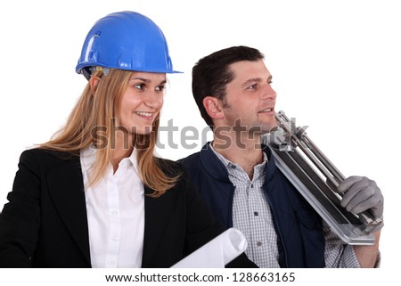 An architect and her foreman. - stock photo