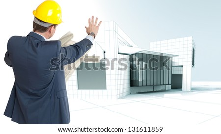 An architect consulting his plans and a modern building on the background - stock photo