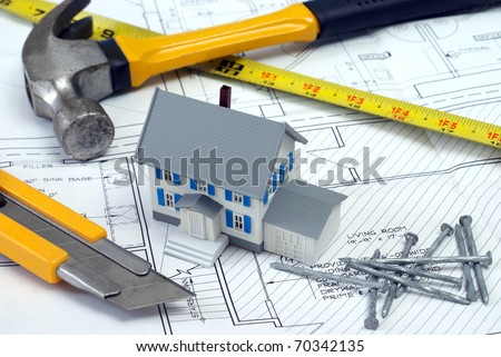 An architect has designed blueprints for a new house project. - stock photo