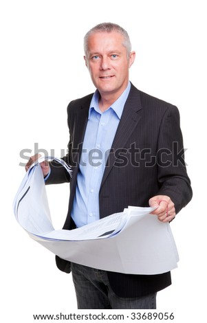An architect holding some generic building plans, isolated on a white background. - stock photo
