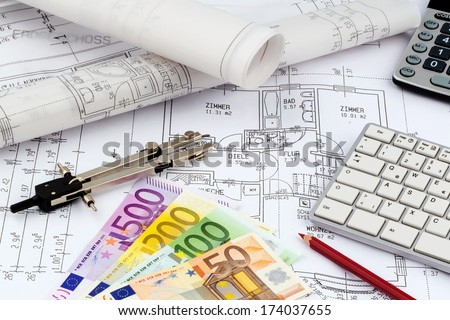 an architect's blueprint with euro money. symbolic photo for funding and planning of a new house. - stock photo