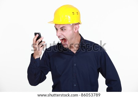An architect yelling at his phone. - stock photo