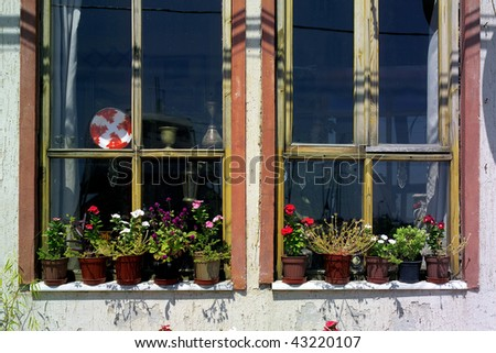 an architectural detail of a ruinous window - stock photo