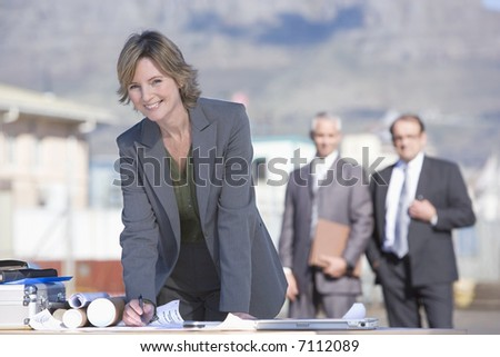 An architectural team on survey - stock photo