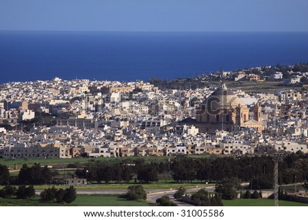 an ariel view of mosta dome, in malta known as the third free standing dome in the world - stock photo