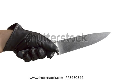 An Arm with black leather gloves holding a large knife - stock photo