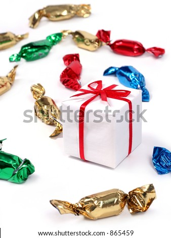 an arrangement of candies and present - stock photo