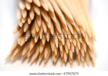 An arrangement of cocktail sticks on a white background - stock photo
