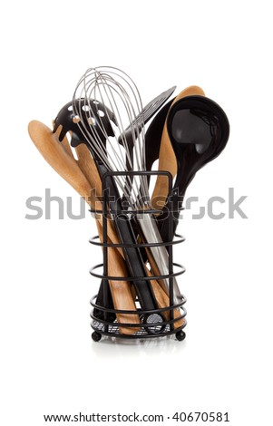 An array of kitchen utensils including wooden spoons, ladle, whisk, spatula and spaghetti ladle on a white background - stock photo