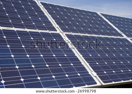 An array of photovoltaic solar panels. Alternative energy - stock photo